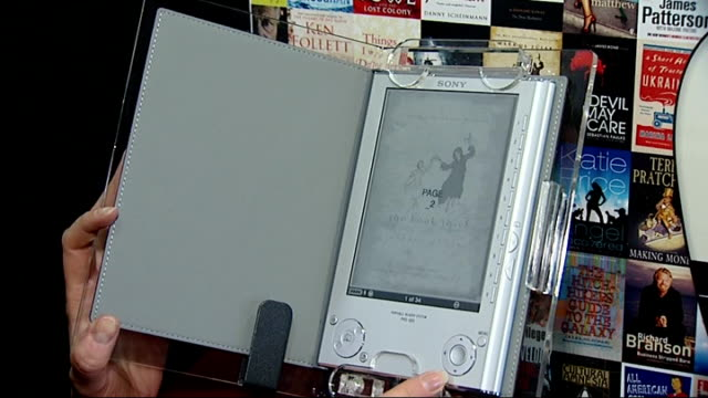 new e-book reader on market; england: london: int sony reader e-book reader being used - literature stock videos & royalty-free footage