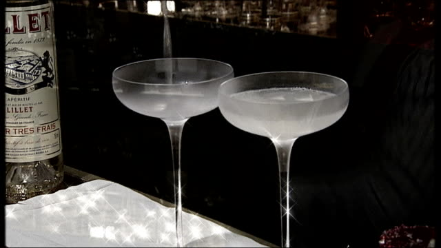 new james bond novel launch bar worker shaking martini martini's being poured out glass of dry martini - martini stock videos & royalty-free footage