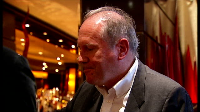 vídeos y material grabado en eventos de stock de new james bond novel launch reporter and boyd clinking glassesand saying cheers sot various shots boyd and reporter talking at bar close up shot... - william boyd