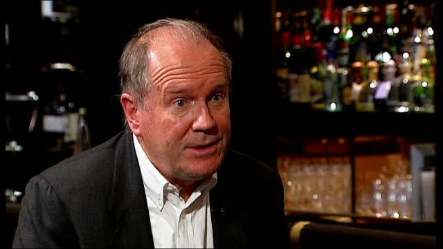 vídeos y material grabado en eventos de stock de new james bond novel launch; william boyd interview sot various shots boyd and reporter talking at bar - william boyd