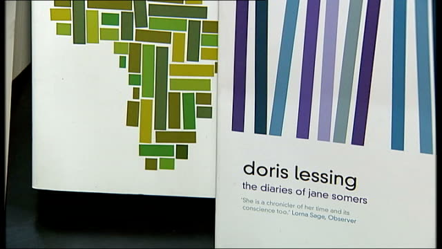 nobel prize-winning writer doris lessing dies aged 94; t11100731 / tx int books written by doris lessing displayed on table and on bookcase shelves... - nobel prize in literature stock videos & royalty-free footage