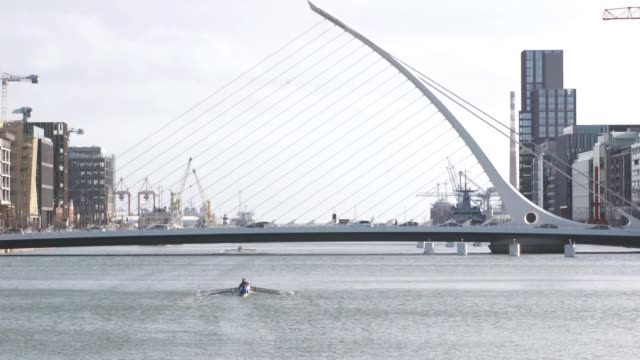 profile of james joyce museums in dublin as voting begins in the irish general election ireland dublin ext people rowing along the river liffey... - james joyce stock-videos und b-roll-filmmaterial