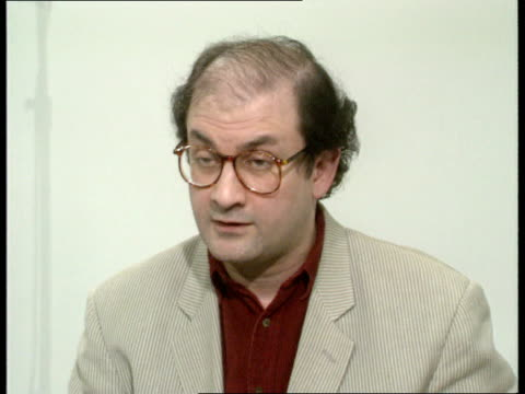salman rushdie interview a england london itn salman rushdie and joan thirkettle travelling in itn new high speed lift ms both through door held open... - religion stock videos & royalty-free footage