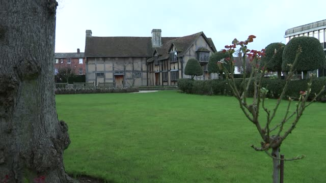 shakespeare's birthplace; england: warwickshire: stratford-upon-avon: ext general view of house and garden / int bedroom inside house / view from... - literature stock videos & royalty-free footage