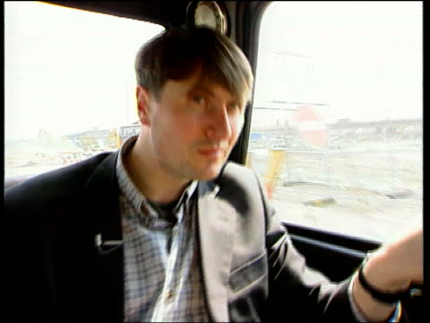 Simon Armitage ENGLAND London Greenwich Simon Armitage sitting in car Millennium Dome construction site seen through car window Simon Armitage...