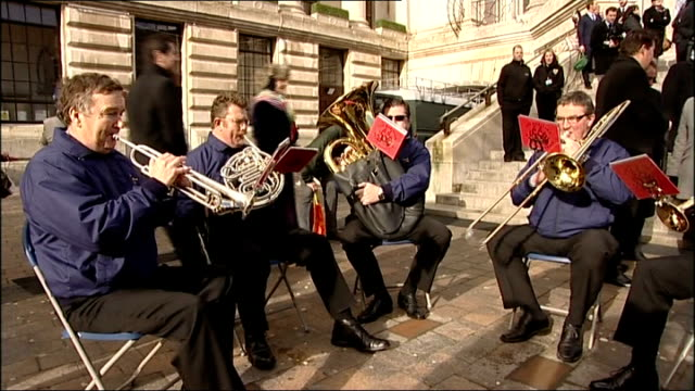 vídeos de stock e filmes b-roll de statue of charles dickens unveiled in portsmouth brass band playing sot - charles dickens