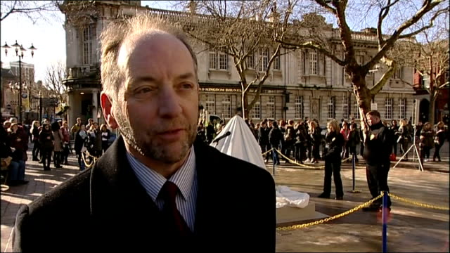 statue of charles dickens unveiled in portsmouth; england: hampshire: portsmouth: ext ian dickens interview sot - charles dickens stock videos & royalty-free footage