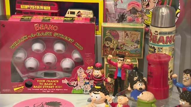 stockvideo's en b-roll-footage met the beano comic turns 80 scotland int close shot of display of beanorelated games and objects close shot of dennis the menace comic strip close shot... - literatuur