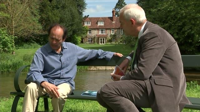Vikram Seth interview ENGLAND Wiltshire Salisbury EXT Home of author Vikram Seth seen through trees Author Vikram Seth along in garden with Jon Snow...