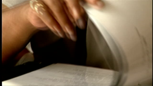 writer and poet maya angelou dies t19019317 / tx maya angelou looking through binder file - poetry stock videos and b-roll footage