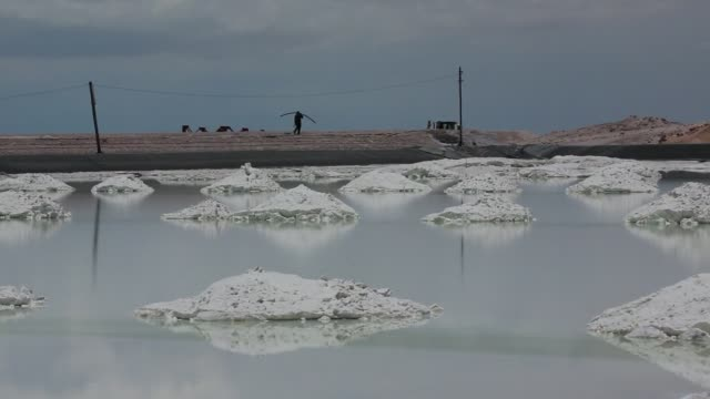 Lithium production at the Uyuni Salt Flats in Boliva on Monday Feb 3 Close up of bags of lithium bicarbonate Wide shot of workers going through...