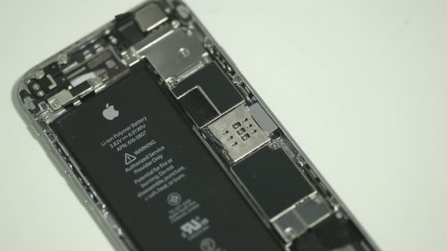 lithium-ion battery is seen inside the rear case of an apple inc. iphone 6 smartphone in an arranged video taken in bangkok, thailand, on friday,... - lithium ion battery stock videos & royalty-free footage