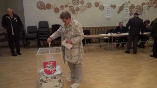 lithuanian voters cast their ballots in the parliamentary elections at a polling station in vilnius lithuania on ocotber 10 2016 - lithuania stock videos & royalty-free footage