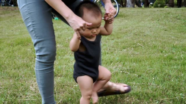litle baby boy doing his first steps - 6 11 months stock videos & royalty-free footage