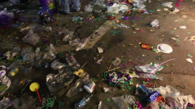 litter and broken beads and other items cover a side walk along at st charles and andrew higgins near lee circle during the bacchus parade during... - gras stock videos and b-roll footage