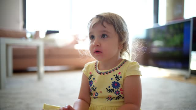 little 2-3 years blonde girl playing toys and talking - 2 3 years stock videos & royalty-free footage