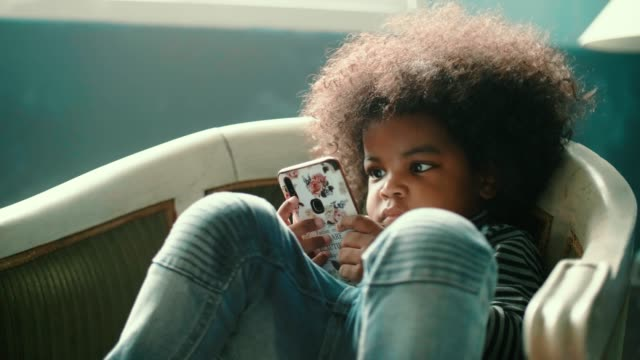 little african girl(2-3 years) watching video from smart phone - 2 3 years stock videos & royalty-free footage