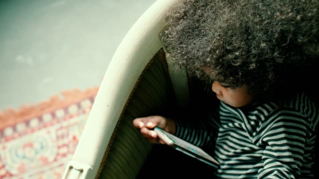 little afro girl playing smart phone - 2 3 years stock videos & royalty-free footage