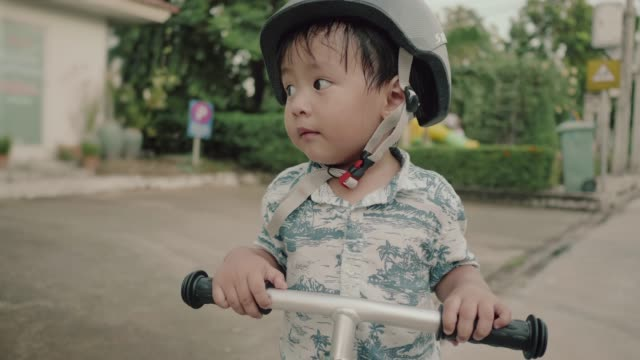 little and happy boy riding bike in park - innocence stock videos and b-roll footage