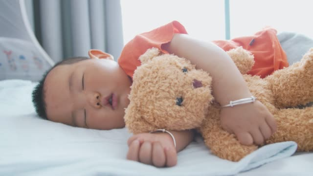 little asian baby boy sleeping with teddy bear - nursery bedroom stock videos & royalty-free footage