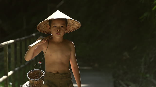 little asian boy going back to his home after he going to catch some fish. - developing countries stock videos & royalty-free footage