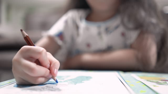 little asian girl coloring at her home - pencil drawing stock videos & royalty-free footage