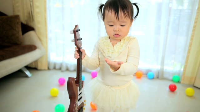 little asian girl with guitar