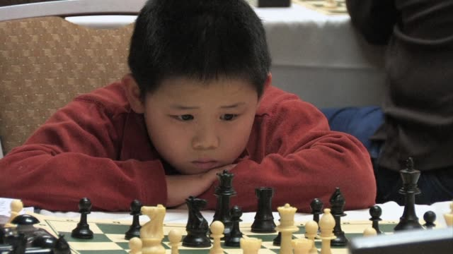 little awonder liang made a big splash in the world of chess last year winning the world championship for the under8 set neenah wisconsin united... - neenah stock videos & royalty-free footage