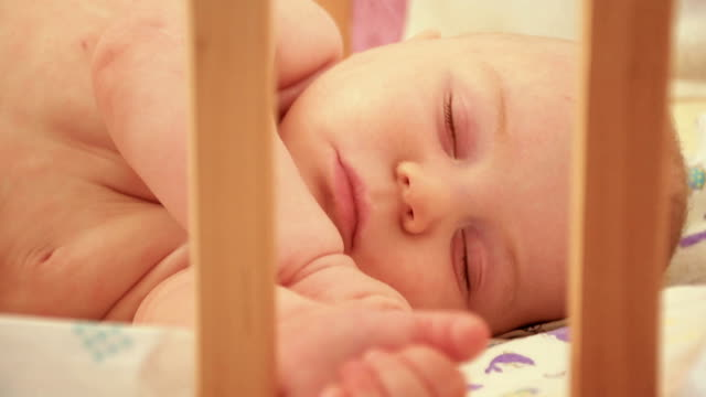 little baby asleep in his crib, close up - nursery bedroom stock videos & royalty-free footage