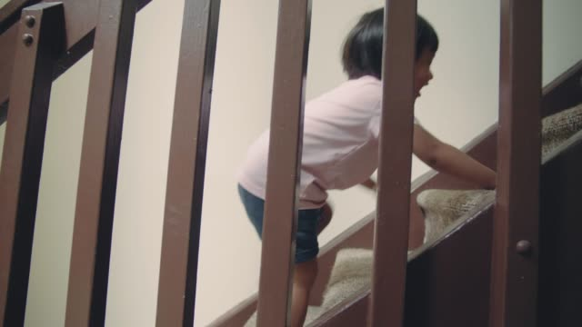 little baby (24 months) boy climbing up the steps - moving up stock videos & royalty-free footage