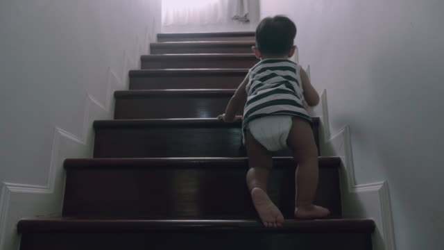 little baby (12 months) boy climbing up the steps - nappy stock videos & royalty-free footage