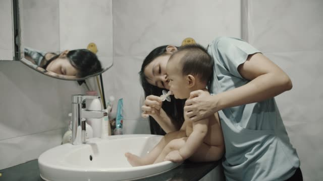little baby boy enjoying brushing teeth with his mom - washing stock videos & royalty-free footage