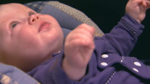little baby boy in an infant seat - baby boys stock videos & royalty-free footage