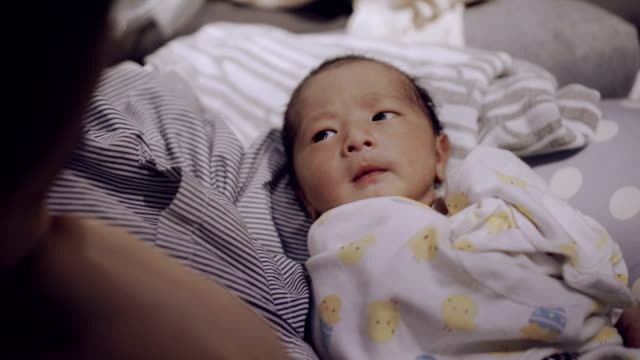 little baby boy (0-1 months) looking at his mother. - 0 1 months stock videos and b-roll footage