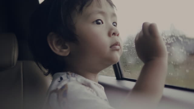 little baby boy looking out from car window - land vehicle stock videos & royalty-free footage