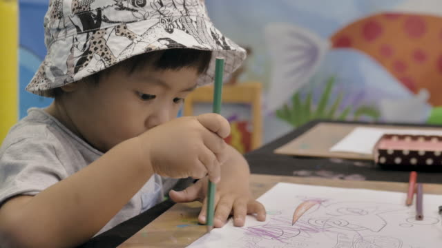little baby boy making a drawing on the table. - 12 23 months stock videos & royalty-free footage
