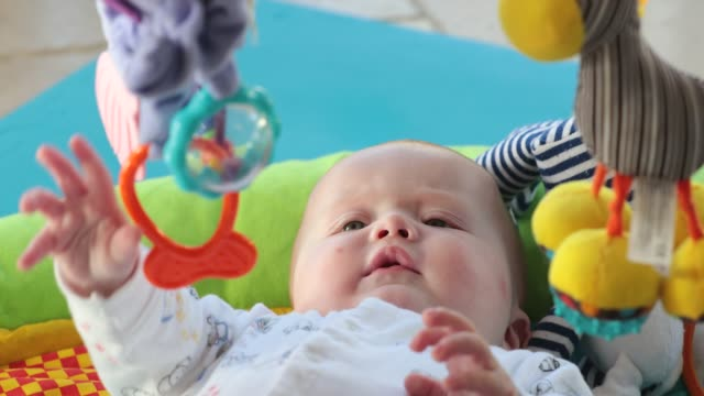 little baby boy playing on playmat - gripping stock videos & royalty-free footage