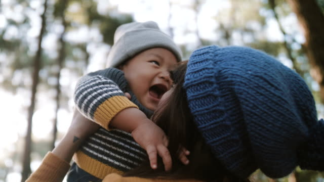 little baby boy playing with his mother. - stringere tenere video stock e b–roll