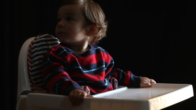 stockvideo's en b-roll-footage met little baby boy sitting on high chair - selimaksan