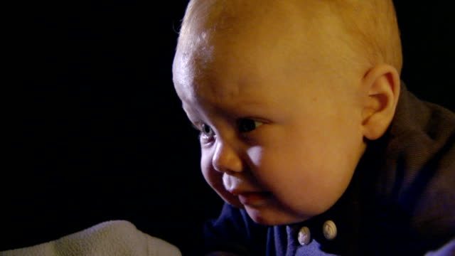 little baby boy sucking thumb, getting up, handheld shot - anno 2004 video stock e b–roll