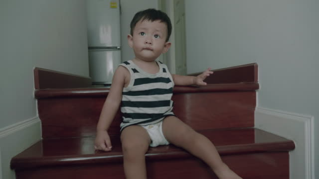 little baby boy walking down stairs at home. - babies only stock videos & royalty-free footage