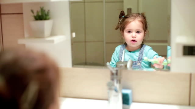 little baby girl brushing  teeth - brushing stock videos and b-roll footage