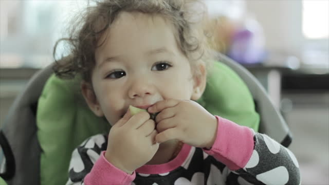 little baby girl toddler eating her breakfast - broccoli stock videos & royalty-free footage