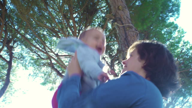stockvideo's en b-roll-footage met little baby laughing happy with his mother - silvestre