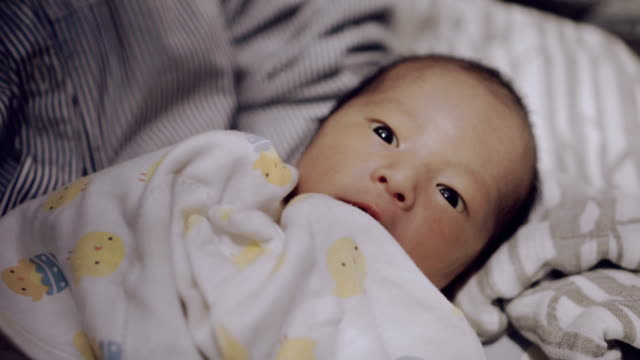 little baby lying on bed at night. - 0 1 months stock videos & royalty-free footage