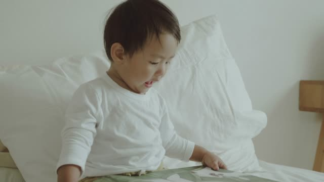 Little Baby Read The Book At Home