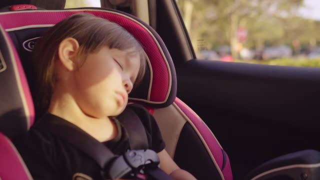 little baby sleeping in safety carseat. - vehicle seat stock videos & royalty-free footage