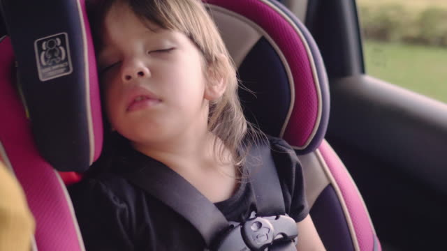 little baby sleeping in safety carseat. - security stock videos & royalty-free footage