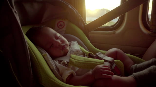 little baby sleeping in safety carseat. - safety stock videos & royalty-free footage