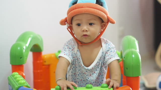 little baby with helmet playing toys - human spine stock videos & royalty-free footage